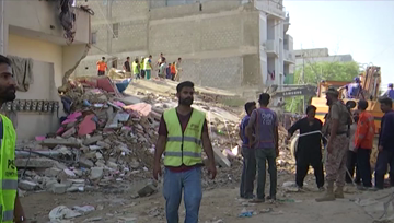 Building collapses in Pakistan's Karachi, one killed.