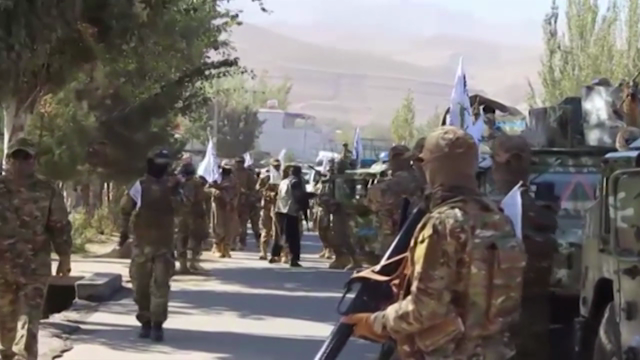 Hundreds of Afghan Soldiers, armed Taliban patrol on the streets of the city bordering Tajikistan in a show of power.